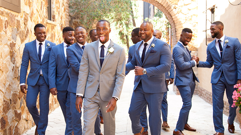 groom and guys walking bella collina